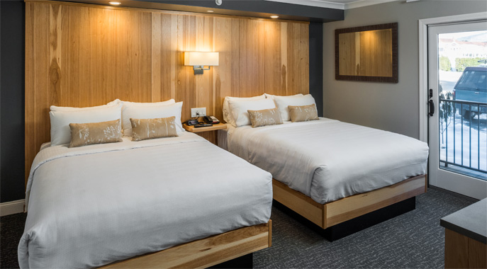 A view of the floor to ceiling hickory headboard in a Lodge Queen Room at the Center Harbor Inn.