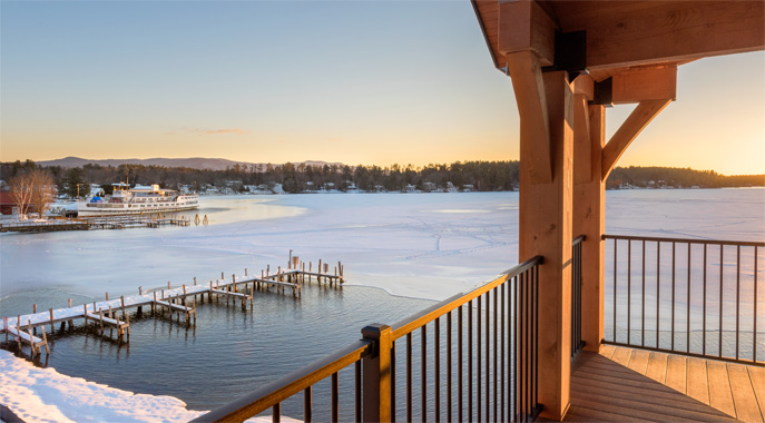 A view from a guest room deck over looking the harbor in the winter time.